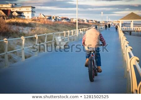 Kabát kék mellény férfiak város bicikli Stock fotó © toyotoyo