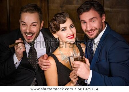 Sigaro ristorante donna capelli fumo Foto d'archivio © boggy