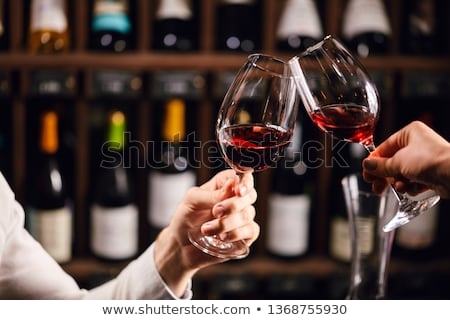 Handsome man with glass of red wine Stock photo © boggy