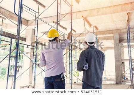 Masculina trabajadores técnica planos edificio Foto stock © feverpitch