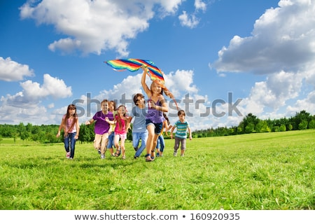 Many children having fun in park Stock photo © colematt