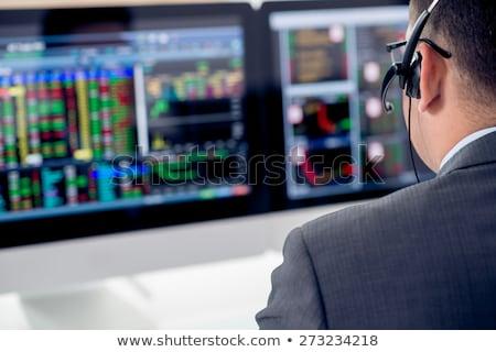 Pénzügyi bróker néz statisztika tőzsde megbeszél Stock fotó © snowing