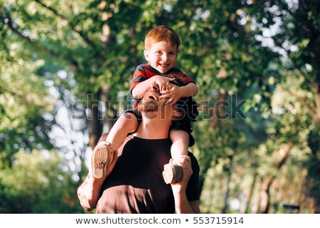 Father And Son on his shoulder In summer season Stock photo © Lopolo