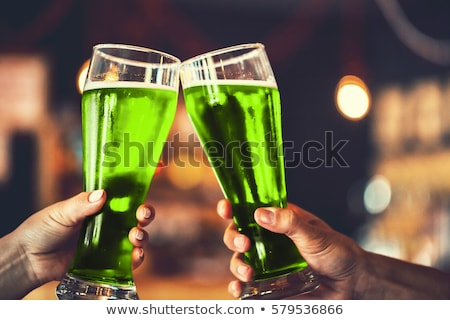 st patricks day green bokeh background with beer mugs stock photo © sarts
