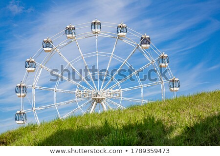 Ferris Wheel Attraction for People during Holidays Stock photo © robuart