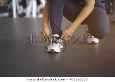 Man tying sneaker shoelace Stock photo © pressmaster