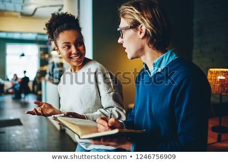 Conversation café deux jeunes affaires Photo stock © pressmaster