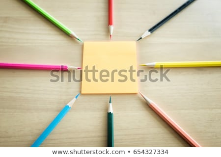 Many different colored pencils put around post it on wooden back Stock photo © Freedomz