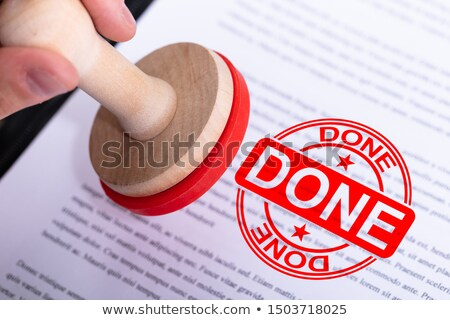 businessman putting done stamp on document stock photo © andreypopov