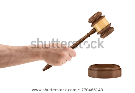 Male lawyer or judge hand's striking the gavel on sounding block Stock photo © Freedomz