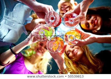 Csoportkép érintés pezsgő szemüveg koktélok buli Stock fotó © ruslanshramko