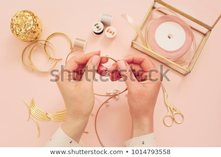 Woman working on a gemstone necklace as a hobby Stock photo © Kzenon