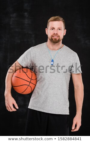 Professional male basketball trainer or player with ball standing in isolation Stock photo © pressmaster