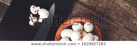 Banner of Fresh whole and sliced mushrooms on a cutting board Stock photo © Illia