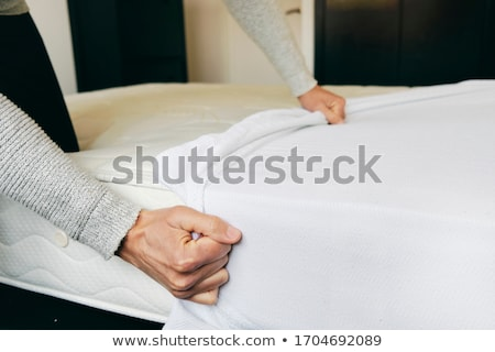 man covering a mattress with a mattress protector Stock photo © nito