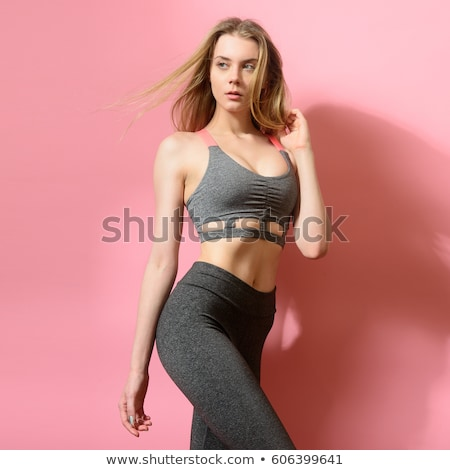 Young fit woman in sportswear posing outdoors Stock photo © GVS