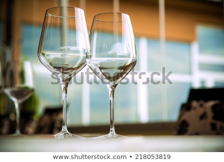 Stok fotoğraf: Wine Glass And Place Setting In A Restaurant