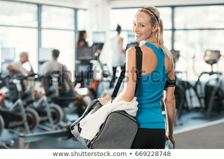 Beautiful blond carrying bags Stock photo © nurrka