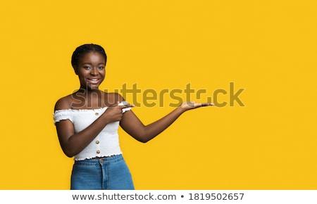 iets · palm · mooie · vrouw · tonen · hand · vrouw - stockfoto © dolgachov