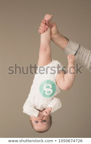 Happy and smiling baby and father. The baby 8 month old. Isolate Stock photo © dacasdo