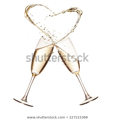 Champagne Splash forme coeur isolé blanche Photo stock © artjazz
