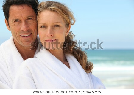 Closeup of a couple on the beach in toweling robes Stock photo © photography33