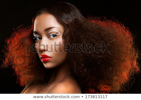 Closeup portrait of a red-haired female model on black backgroun stock photo © Massonforstock