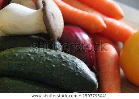 Raw mushrooms and potatoes in red trays Stock photo © elly_l