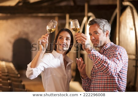 Stock photo: couple tasting wine in a cellar