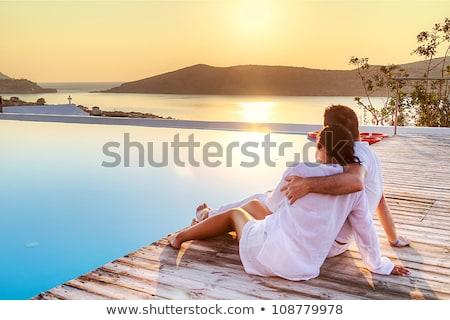 ストックフォト: Happy Couple Hugging In A Swimming Pool