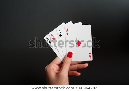 woman holding four aces stock photo © photography33