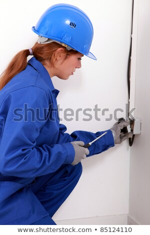 Young female trades apprentice wiring a power point Stock photo © photography33