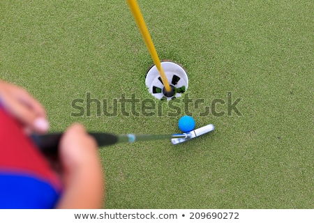 Stock fotó: Small Child Playing Golf On A Putting Green