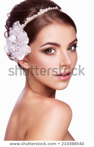 Brunette beauty posing with a flower Stock photo © konradbak