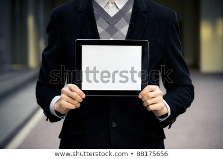 empresário · eletrônico · tocar · comprimido · isolado - foto stock © stockyimages