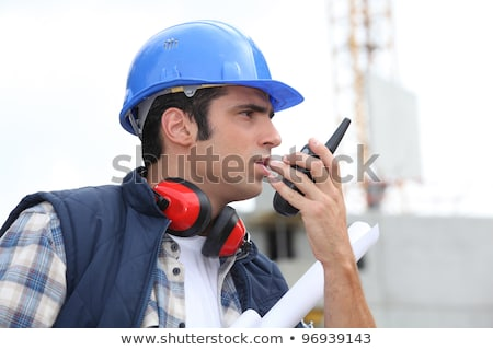 A foreman giving instructions through his cb. Stock photo © photography33