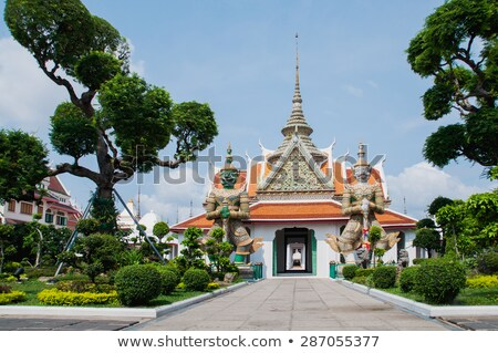 wat arun temple in bangkok on the shore of the chao phraya river stock photo © jakgree_inkliang