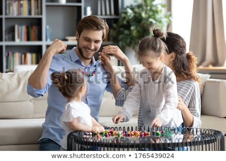 Young girl playing with mommy's jewelry Stock photo © photography33