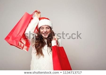 Santa girl with red shopping bag Stock photo © photosebia