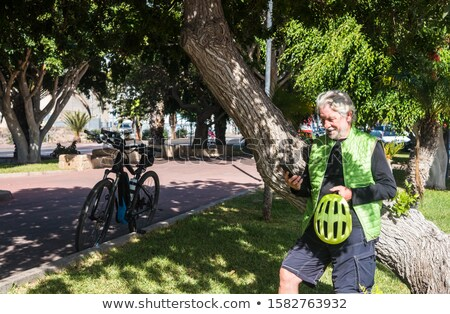 senior · homem · ciclo · exercer · bicicleta · sorridente - foto stock © photography33