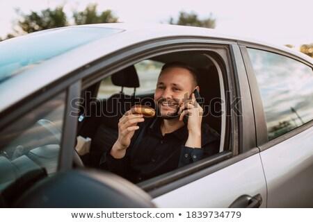 Feliz jóvenes masculina conductor sesión coche Foto stock © wavebreak_media