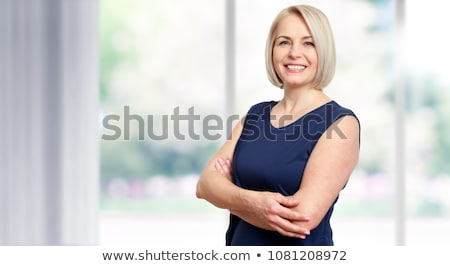 cheerful confident middle aged business lady stock photo © stockyimages