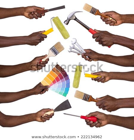 Man holding colour samples and a paintbrush Stock photo © photography33