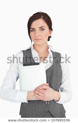 blue eyed businesswoman holding a digital tablet against white background stock photo © wavebreak_media