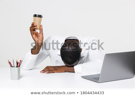 Tired young businessman with a coffee at his computer Stock photo © photography33