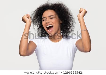 Młoda kobieta zwycięstwo odizolowany tle młodych Zdjęcia stock © pablocalvog