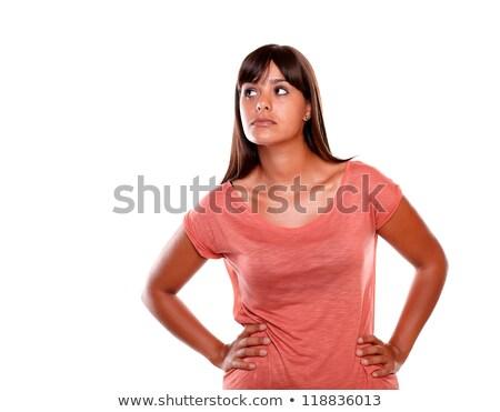 zamyślony · młoda · kobieta · patrząc · w · górę · biały - zdjęcia stock © pablocalvog