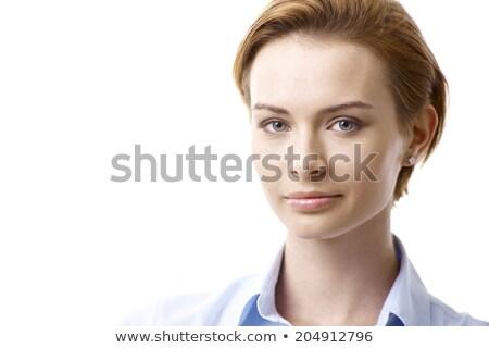 Komoly fiatal nő felfelé néz kék blúz fehér Stock fotó © pablocalvog