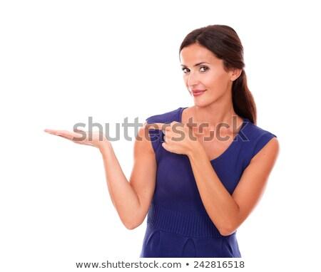 Genç kadın işaret doğru yalıtılmış kadın Stok fotoğraf © pablocalvog