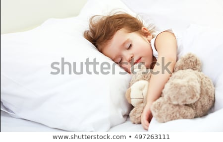 cute · nina · osito · de · peluche · cama · casa - foto stock © wavebreak_media